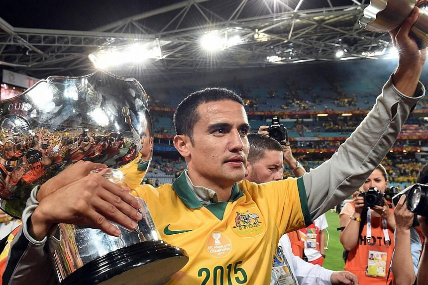 Australia's Tim Cahill celebrating after beating South Korea in the AFC Asian Cup football final at Stadium Australia in Sydney on Jan 31, 2015. -- PHOTO: AFP
