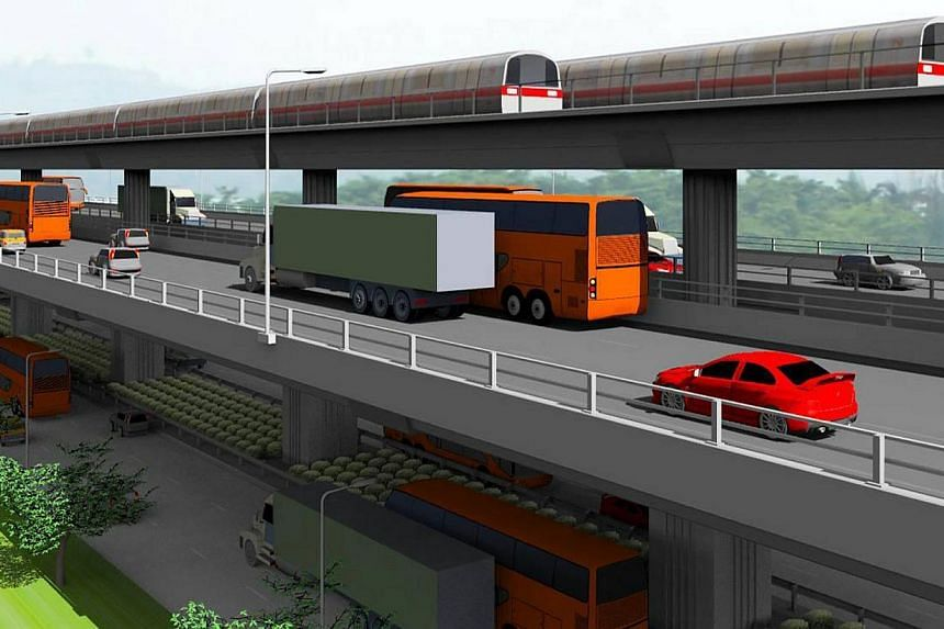 An artist's impression of the Tuas West Extension, which goes over the Ayer Rajah Expressway viaduct. -- PHOTO: LTA