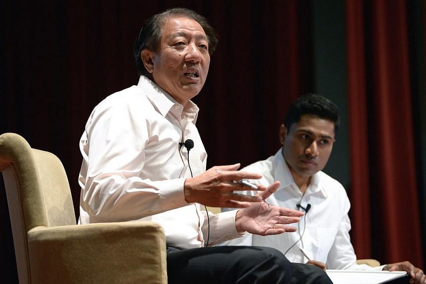 Student Moderator Kubaren Algasamy (right) with Deputy Prime Minister Teo Chee Hean who is also Coordinating Minister for National Security and Minister for Home Affairs at the Q&A session at ADM Auditorium, School of Art, Design and Media, Nanya