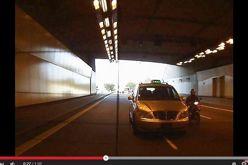 An SMRT taxi driver involved in a road bullying incident has been fired by the company. -- PHOTO: YOUTUBE