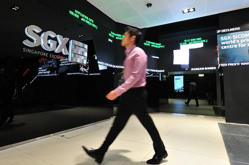 Local shares slipped on Tuesday as ongoing concerns over global economic growth weighed down the market. -- ST PHOTO: LIM YAOHUI