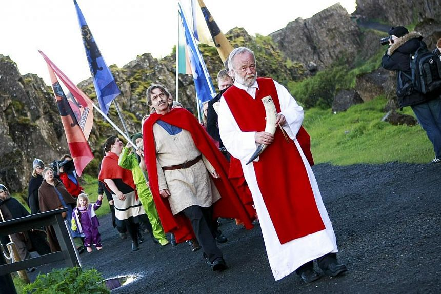 High priest of the Asatru Association, Hilmar Orn Hilmarsson, leading a procession at the Pingvellir National Park near Reykjavik on June 21, 2012. Construction is starting this month on Iceland's first major temple to the Norse gods since the Viking