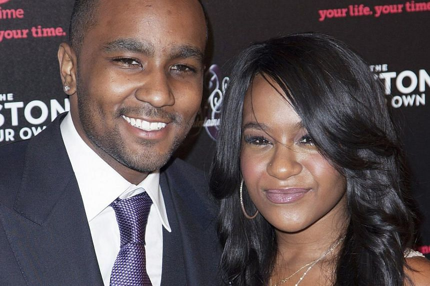 Bobbi Kristina Brown (right) and Nick Gordon attend the opening night of The Houstons: On Our Own in New York, in this file photo taken Oct 22, 2012. Brown, daughter of singer Bobby Brown and his late wife, Whitney Houston, is fighting for her life a