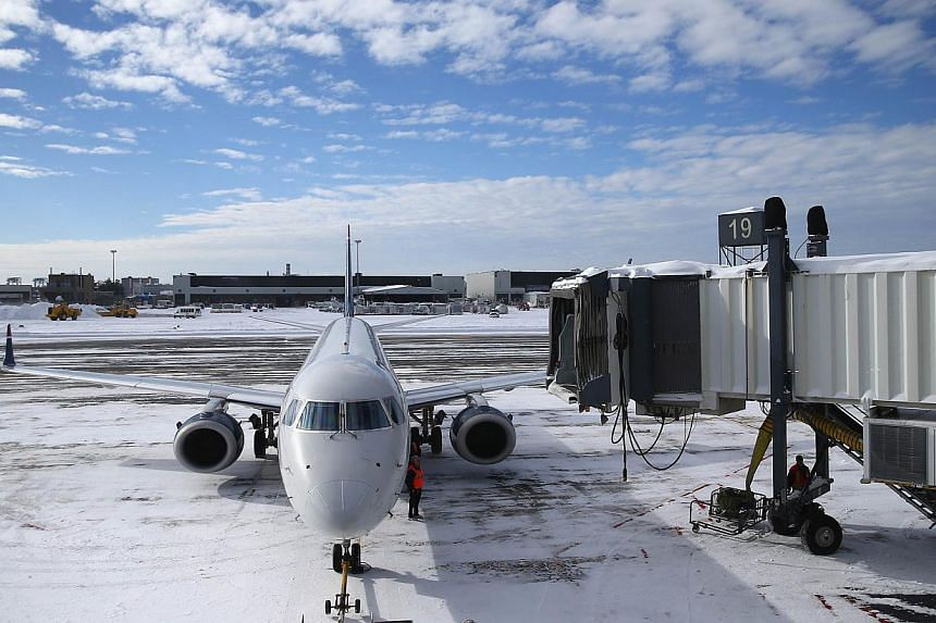 A plane taxis into its gate at Boston's Logan International Airport after the area was hit by Winter Storm Juno last week. Another storm is hitting the US Northeast today that is cancelling flights and causing havoc from Chicago to Cleveland and agai