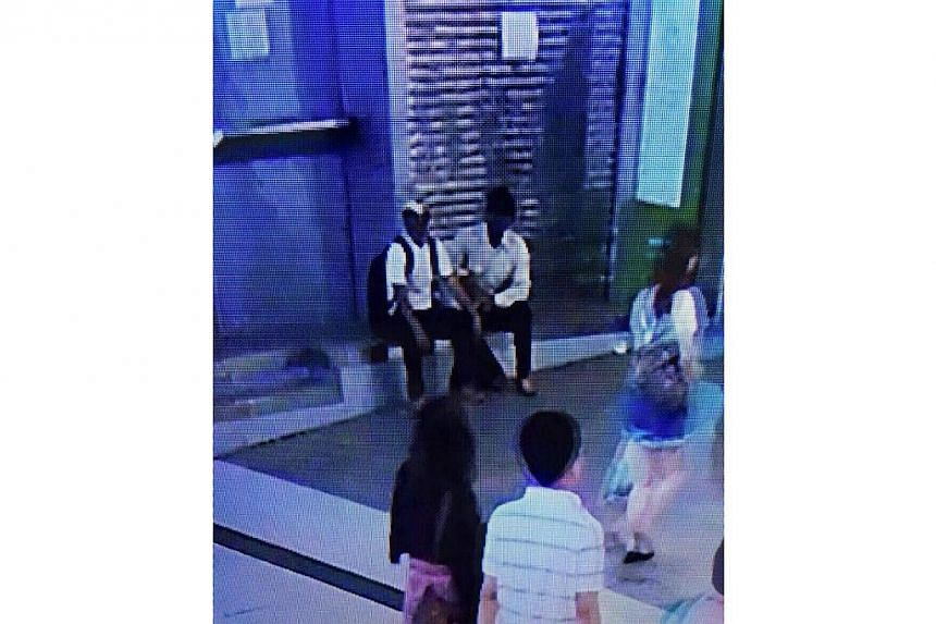 City police were trying to identify two men seen in a security-camera footage outside Siam Paragon shopping mall shortly before two pipe bombs exploded there Sunday night. -- PHOTO: THE NATION/ASIA NEWS NETWORK