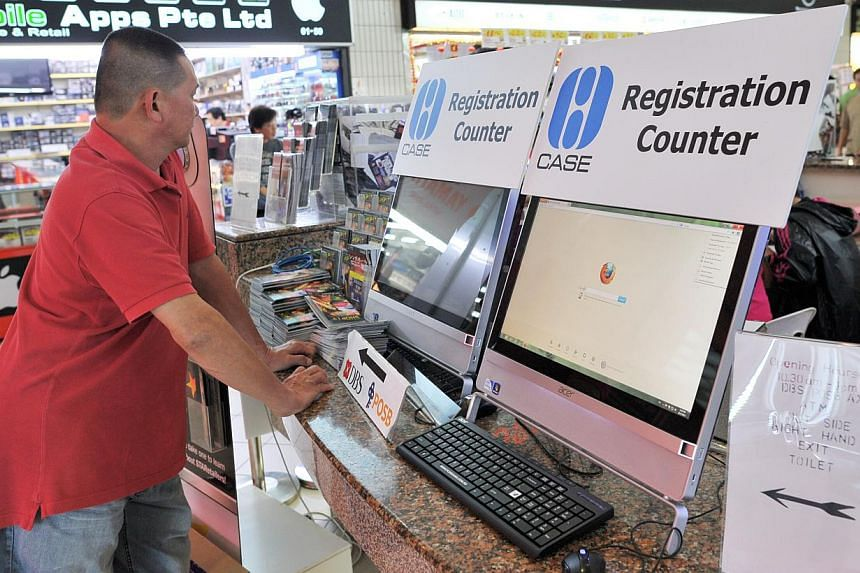 A man standing at the Consumers Association of Singapore complaints kiosk at Sim Lim Square. -- PHOTO: ST FILE