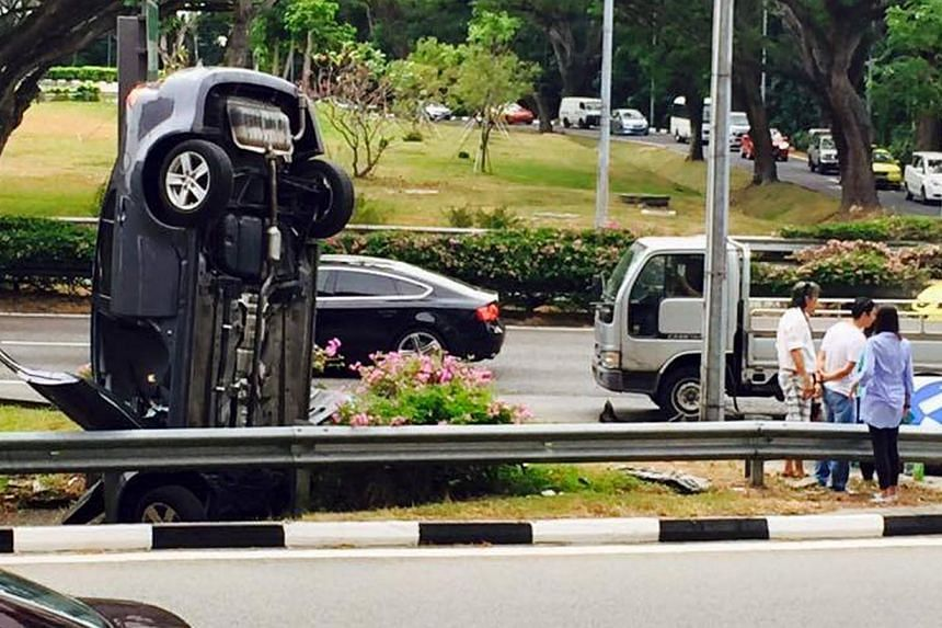 A car seen standing upright on the Pan-Island Expressway (PIE) near Tampines Ave 5 exit. -- PHOTO: FACEBOOK / JOHNSON CHONG