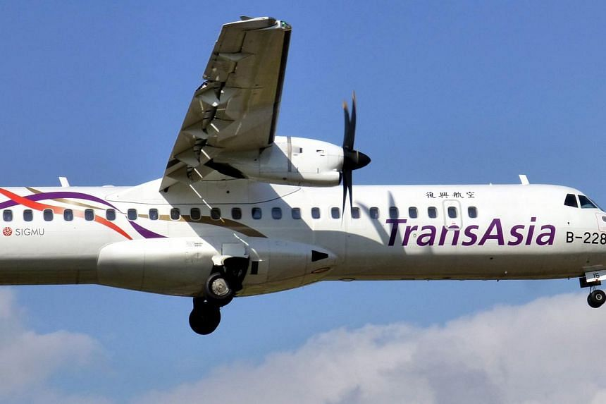A photograph made available on Feb 4, 2015, shows an ATR 72 mid-range, twin-engined turboprop passenger plane of TransAsia Airways taking off from the Taipei Sungshan Airport in Taipei, Taiwan on Dec 6, 2014. A TransAsia Airways plane crashed in