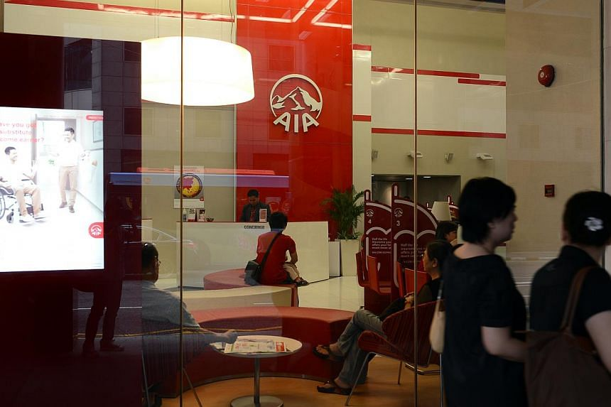 AIA Group, Prudential and Manulife Financial Corp are among firms shortlisted to become the insurance partner of Singapore's DBS in a bank distribution deal worth around US$1.5 billion (S$2 billion), people familiar with the matter said. -- PHOTO: ST