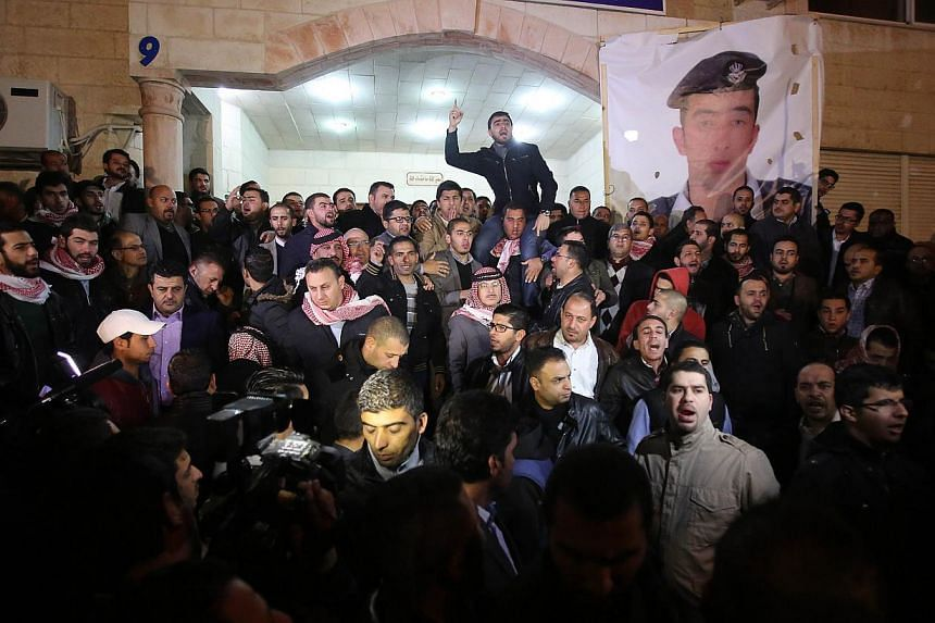 Supporters and family members of Jordanian pilot First Lieutenant Maaz al-Kassasbeh, 26-year-old, gather following his reported killing, at the Karak tribal gathering chamber or Diwan, in the Jordanian capital Amman on Feb 3, 2015. -- PHOTO: AFP