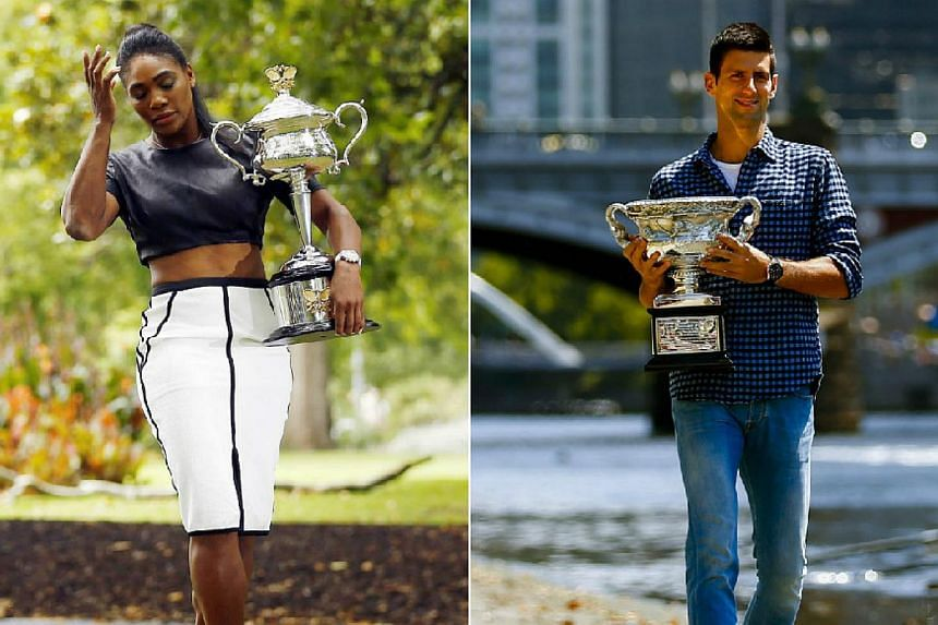 Serena Williams of the US and Serbia's Novak Djokovic pose with their 2015 Australian Open trophies. -- PHOTOS: REUTERS