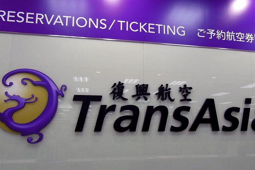 A TransAsia Airways logo at their counter at Taipei Songshan airport in Taipei, Taiwan, 23 July, 2014.Relatives of some passengers on board the TransAsia Airways plane that crashed in Taipei on Wednesday have lashed out at the company for not i