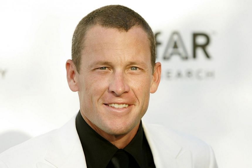 Disgraced cycling champion Lance Armstrong crashed his car into two parked vehicles and let his girlfriend take the rap after a night out, reports said on Tuesday. -- PHOTO: REUTERS