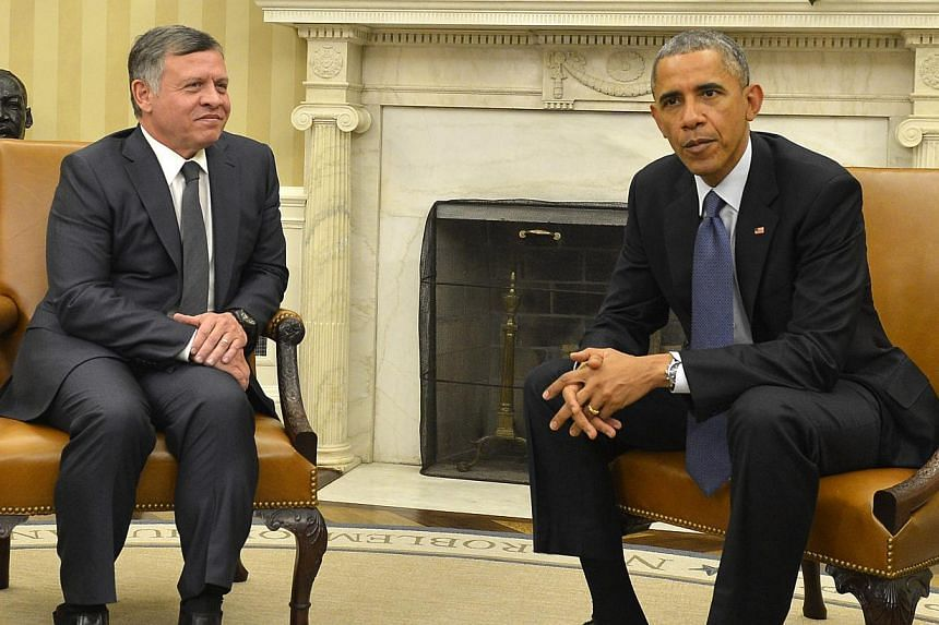 US President Barack Obama (right) speaking with Jordanian King Abdullah II in the Oval Office at the White House, in Washington, DC on Feb 03, 2015. --PHOTO: EPA