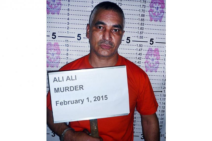 """This handout photo taken on Feb 1, 2015, and received from Philippine National Police-Dipolog City station (PNP-DIPOLOG) on Feb 4, shows a mug shot of Australian tourist Ali Ali accused of the """"brutal"""" murder of a Filipina teenager he met on the Inte"""
