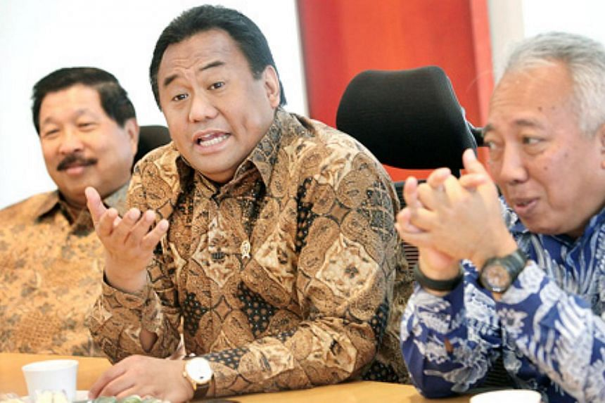 Indonesian Trade Minister Rachmat Gobel (center) speaks at a meeting in Jakarta on Dec 22, 2014, flanked by his special advisers Johnny Darmawan (left) and Benny Soetrisno. Mr Gobelsparked anger on Wednesday, Feb 4, 2015, after saying that seco