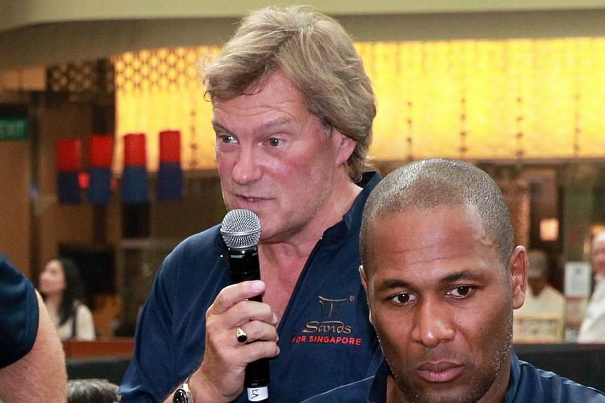 Tottenham Hotspur greats Glenn Hoddle (left) and Les Ferdinand at a soccer clinic conducted for youngsters at the Marina Bay Sands on June 20, 2013.The fall-out from Harry Redknapp's resignation as Queens Park Rangers manager continued on Wedne