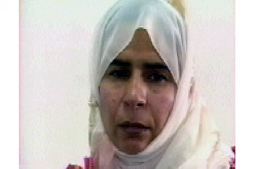 Jordan has executed by hanging jailed Iraqi woman militant Sajida al-Rishawi (above) whose release had been demanded by the Islamic State in Iraq and Syria (ISIS). -- PHOTO: AFP