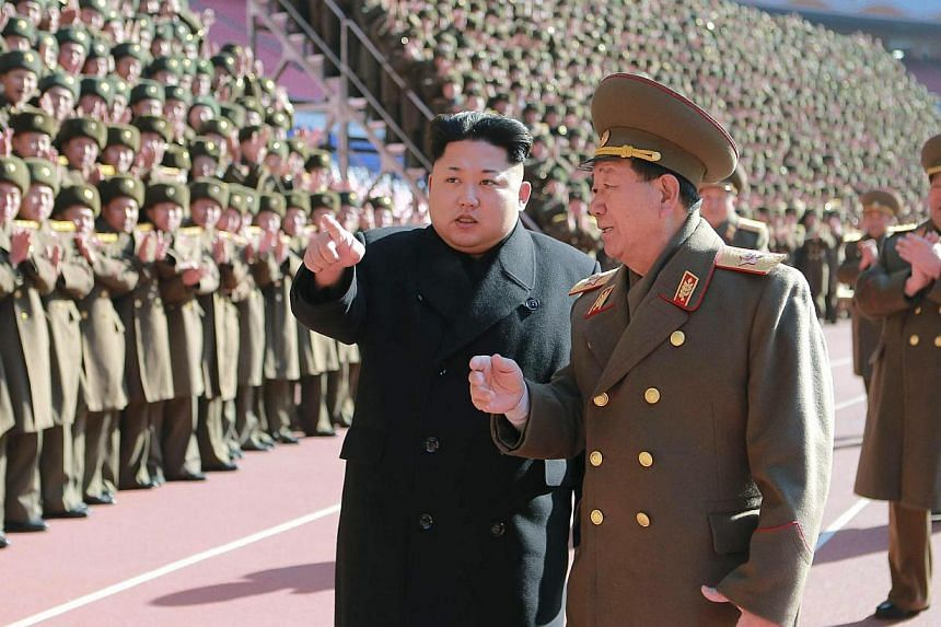 North Korean leader Kim Jong Un (centre) gesturing during a photo session at a meeting of military and political cadres in this undated photo released by North Korea's Korean Central News Agency in Pyongyang on Feb 2, 2015. -- PHOTO: REUTERS