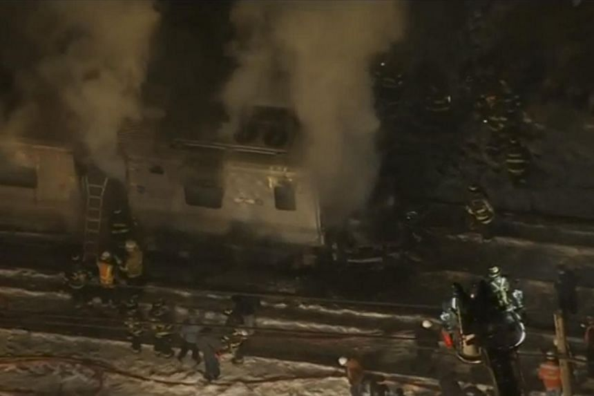Still images of aerial video showing first responders battling fire on a New York City Metro-North train following an accident near Valhalla, New York on Feb 3, 2015. At least six people died on Tuesday evening when a New York commuter train struck a
