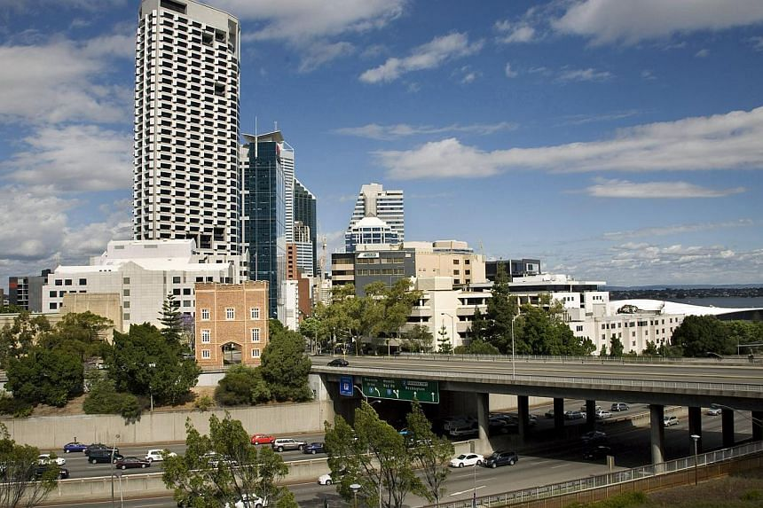 Downtown Perth in 2008. Mainboard-listed developer Sim Lian announced on Wednesday that it is acquiring an office complex in the Australian city for A$72.8 million (S$76 million). -- PHOTO: BLOOMBERG