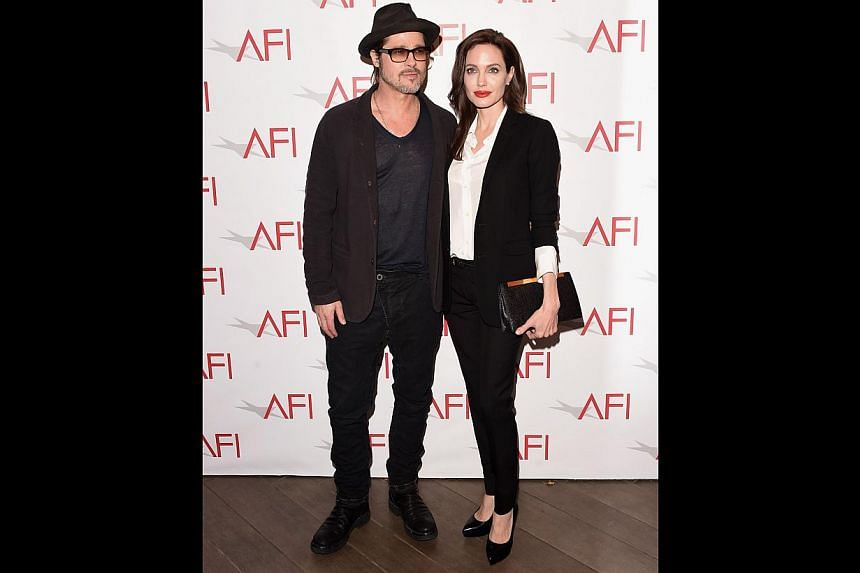 Director Angelina Jolie (above, with husband Brad Pitt) who directed Unbroken, about Olympic athlete Louis Zamperini surviving being adrift at sea and a gruelling experience in a Japanese war camp. -- PHOTO: AGENCE FRANCE-PRESSE