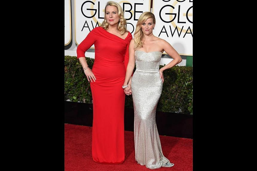 Author Cheryl Strayed (left) with Reese Witherspoon, who plays her in the movie Wild. -- PHOTO: AFP