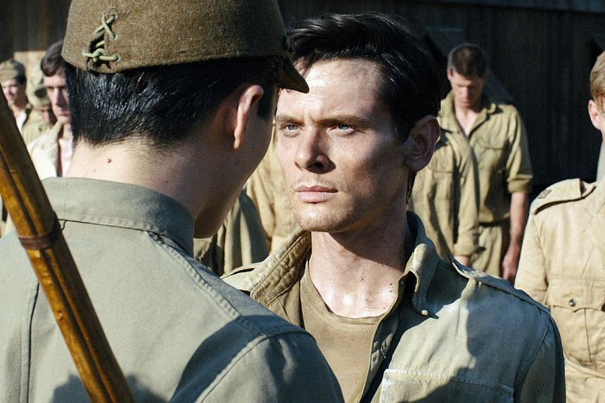 Director Angelina Jolie who directed Unbroken (above), about Olympic athlete Louis Zamperini surviving being adrift at sea and a gruelling experience in a Japanese war camp. -- PHOTO: UIP