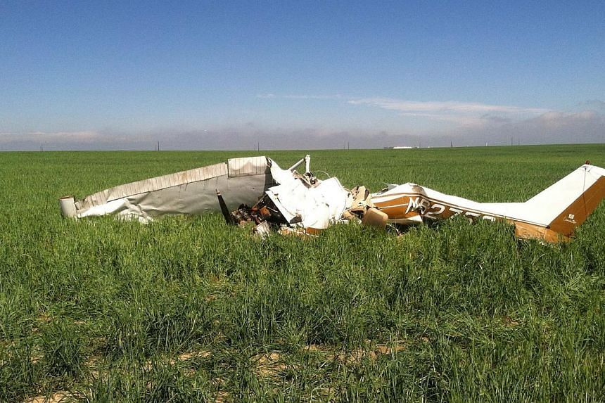 The wreckage of the crashed Cessna 150 airplane lying in a field near Watkins, Colorado on May 31, 2014. The pilot was taking selfie pictures with his phone before he crashed, killing himself and a passenger, investigators found. -- PHOTO: REUTERS