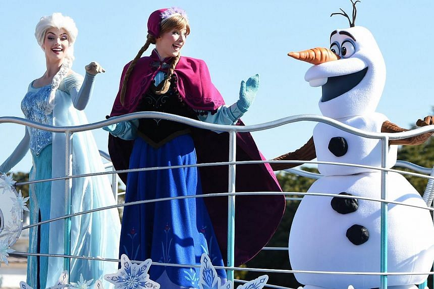 Disney characters from the animated movie Frozen performing on a float during the new parade Anna And Elsa's Frozen Fantasy at Tokyo Disneyland in Urayasu, suburban Tokyo, on Jan 13, 2015. -- PHOTO: AFP