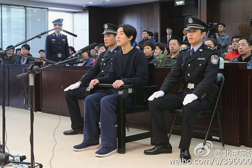 Actor Jaycee Chan attends a trial at a court in Beijing on Jan 9, 2015. Actor Jackie Chan says he and his wife will not be in Beijing to welcome their son Jaycee when he leaves prison. -- PHOTO: REUTERS