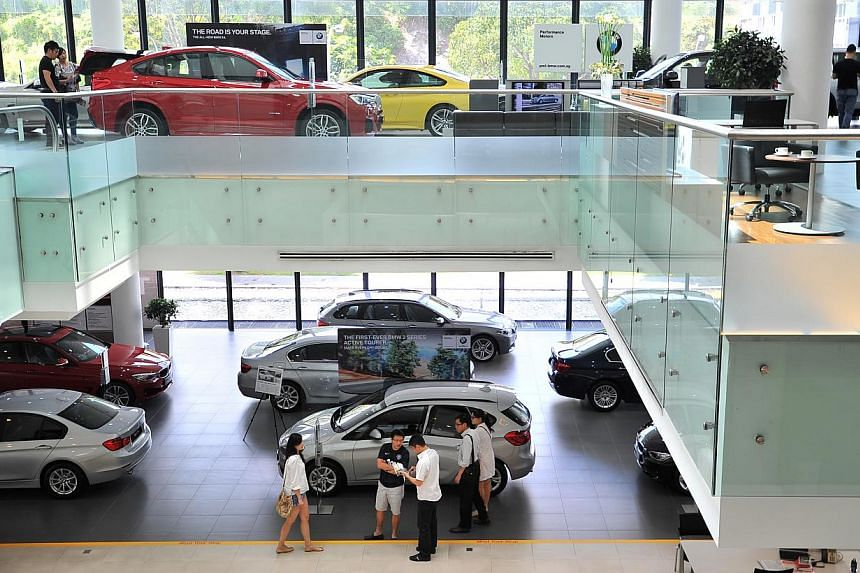 Performance Motors (BMW) at 303 Alexandra Road on Jan 17, 2015.Certificates of entitlement (COE) premiums ended mostly lower in the latest tender on Wednesday. -- PHOTO: ST FILE