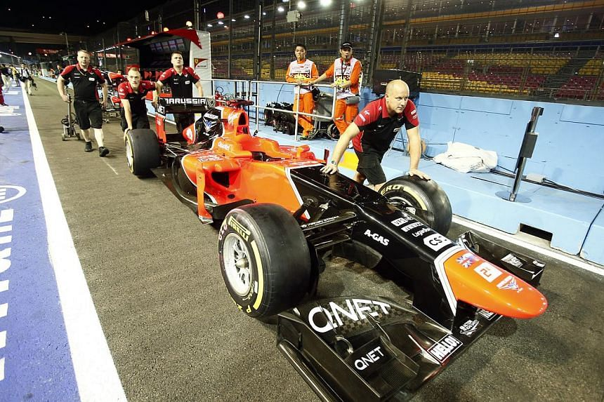 The Marussia F1 team push their car out of the garage, a day before the SingTel Singapore Grand Prix 2012 Formula One practice session, at the F1 pit building on Singapore's Marina Bay Circuit on Sep 20, 2012.The troubled F1 team could start th