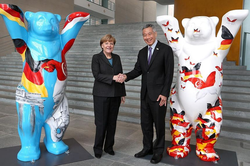 German Federal Chancellor Angela Merkel and Prime Minister Lee Hsien Loong shake hands at the Federal Chancellery in Berlin on Feb 3, 2015. When Prime Minister Lee Hsien Loong met German Chancellor Angela Merkel in Berlin on Tuesday, they posed