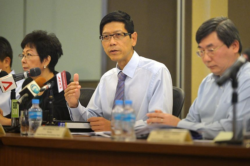 Professor Tan Chorh Chuan (centre) chairing the CPF Advisory Panel press conference to announce its recommendations on how to make the CPF system more flexible on Feb 4, 2015 at the Ministry of Manpower. -- ST PHOTO: ALPHONSUS CHERN