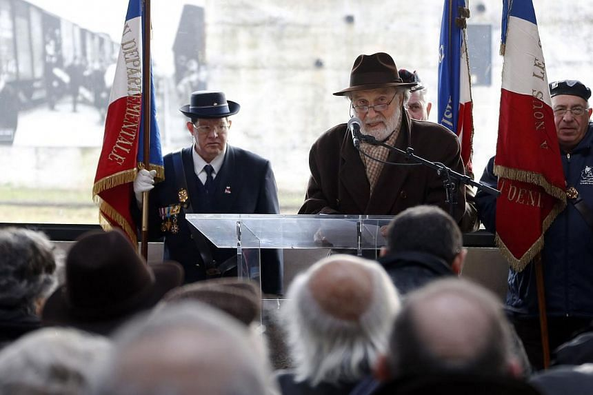 Jewish leaders in France address a crowd during the inauguration of the renovated goods shed of a former train station in Bobigny, north-east of Paris, last week, to mark the international day of Holocaust remembrance and the 70th anniversary of the