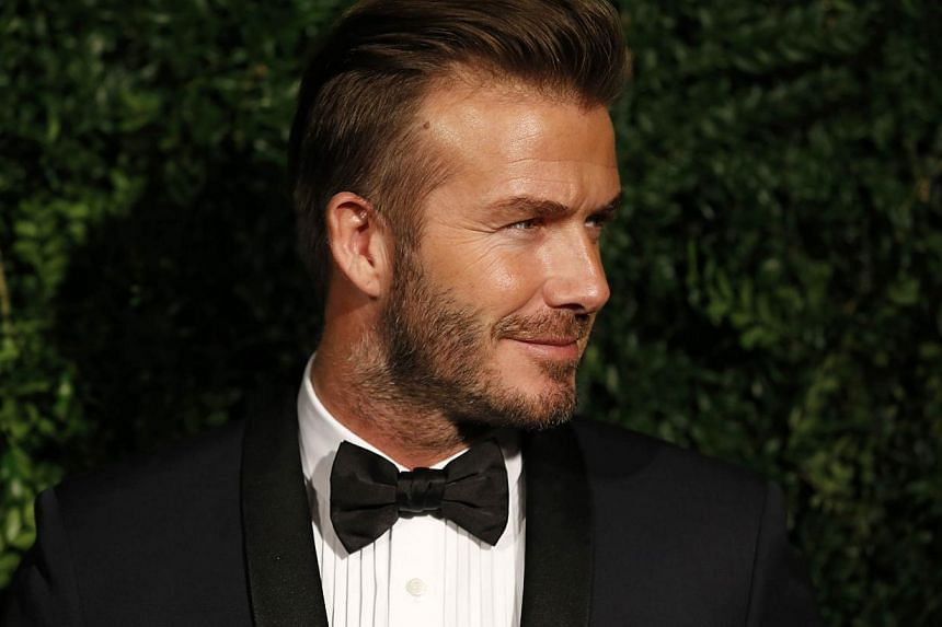 Former England football captain David Beckham poses on the red carpet as he attends the 60th London Evening Standard Theatre Awards 2014 in London in November last year. -- PHOTO: AFP