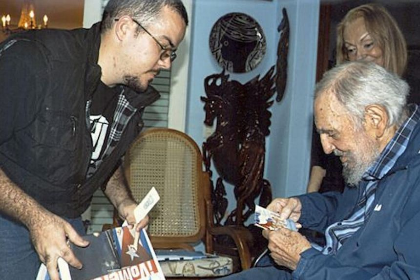 In this hand-out picture by the official Cuban website www.cubadebate.cu shows Randy Garcia Perdomo (left), the leader of a students' union, speaking with former Cuban President Fidel Castro (right) during a visit to Castro's residence on Jan 23 in H