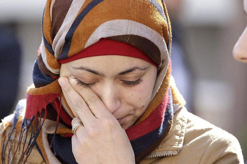 Anwar Tarawneh (centre), the wife of Jordanian pilot Maaz al-Kassasbeh, weeps for her husband at a rally calling for his release on Feb 3, 2015, in Jordanian capital Amman. It is now thought her husband was burned alive by ISIS militants a month ago.