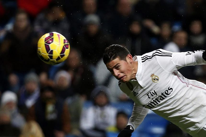 Real Madrid's James Rodriguez scores against Sevilla during their Spanish first division soccer match at Santiago Bernabeu stadium in Madrid on Feb 4, 2015. -- PHOTO: REUTERS