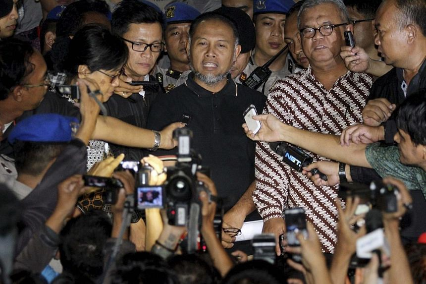 """Bambang Widjojanto (centre), deputy chief of the the Corruption Eradication Commission (KPK), speaks to the media after his release at police headquarters in Jakarta on Jan 24, 2015. Indonesia's popular anti-graft agency will be left """"paralysed"""" if p"""
