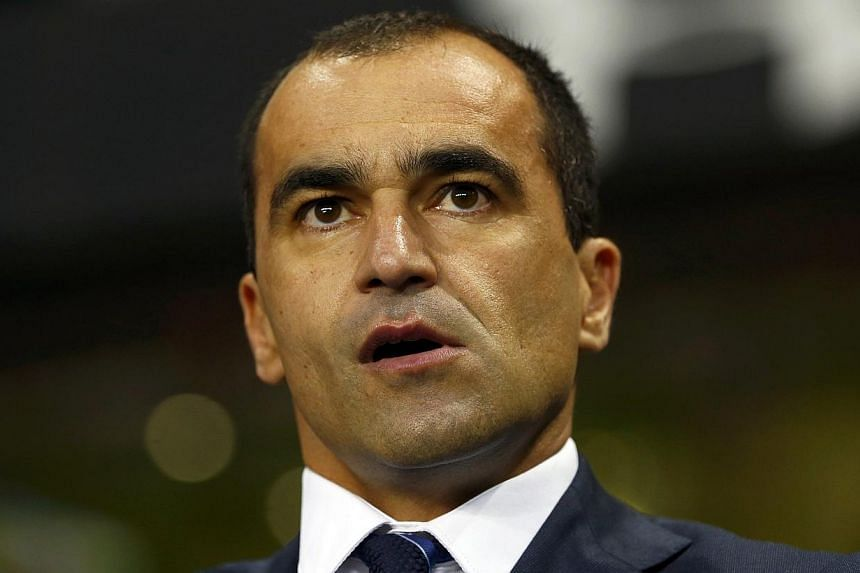 Roberto Martinez watches before their English Premier League soccer match against Tottenham Hotspur at White Hart Lane in London on Nov 30, 2014. The Everton manager says new signing Aaron Lennon can hit the ground running and play a massive role for
