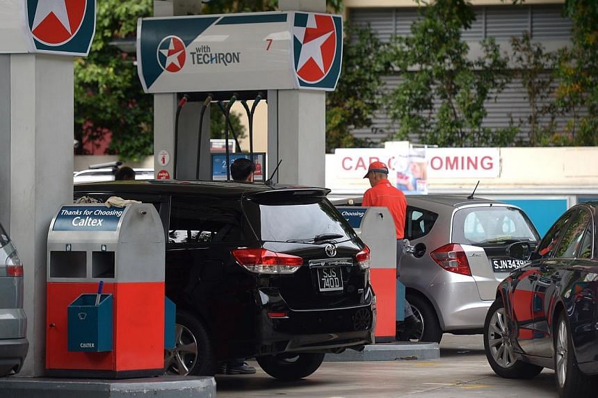 Petrol prices are creeping back up, after falling in January to rates last seen in 2009, with Caltex and Shell revising their prices on Wednesday, Feb 4, 2015, followed by Esso on Thursday. -- PHOTO: ST FILE