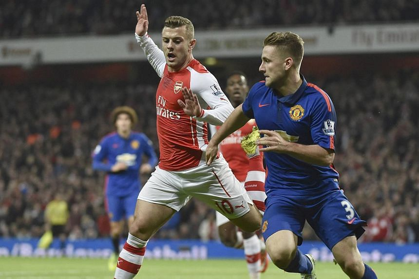 Pictures have emerged online of Jack Wilshere (left) holding a shisha pipe at a nightclub. -- PHOTO: REUTERS