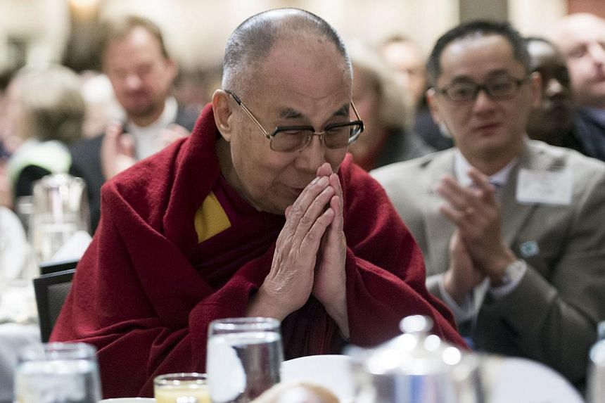 The Dalai Lama is introduced during the National Prayer Breakfast in Washington, DC, Feb 5, 2015. -- PHOTO: AFP