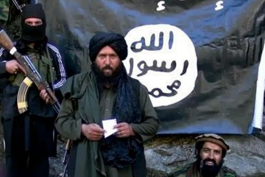 An image made from a video released by the Islamic State in Iraq and Syria (ISIS) on Jan 27, 2015, purportedly showing Hafiz Said Khan (centre), head of the ISIS branch in Pakistan and Afghanistan. ISIS has killed three Chinese militants wh