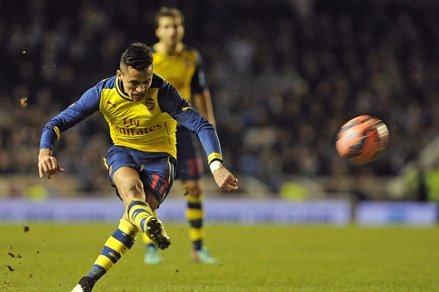 Arsenal forward Alexis Sanchez taking a free kick against Brighton during their FA Cup fourth round football match at the American Express Community Stadium in Brighton on Jan 25, 2015.-- PHOTO: EPA