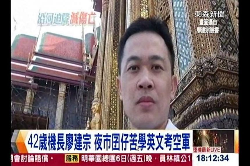 Pilot Liao Chien-tsung was applauded by aviation experts for apparently steering the plane away from populated areas and high-rise buildings to avoid causing more damage with the aircraft. -- PHOTO: YOUTUBE