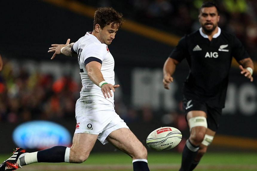 In this file picture taken on June 21, 2014, England's Danny Cipriani clears the ball under pressure from the New Zealand defence during the third rugby union test match in Hamilton. Luther Burrell and Jonathan Joseph will form a new midfield partner