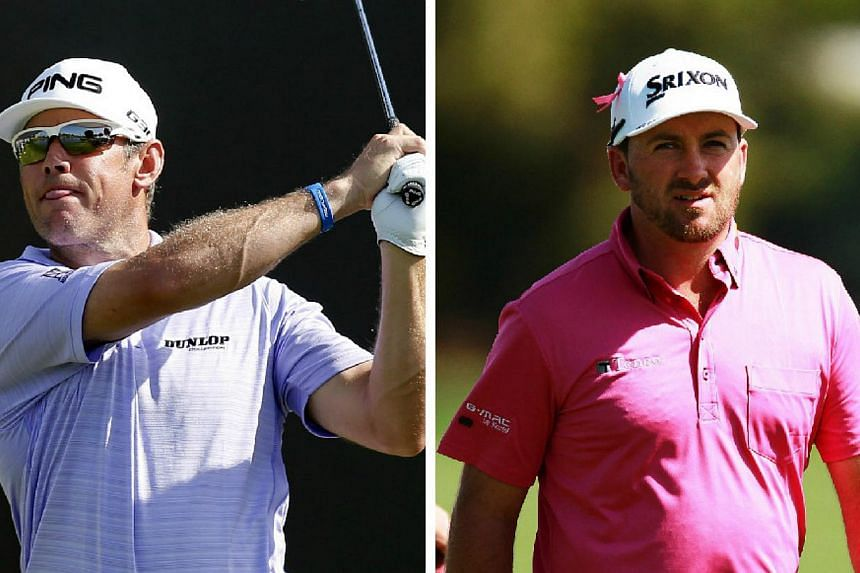 Former world No.1 Lee Westwood (left) made a good start to his Malaysian Open title defence on Thursday, Feb 5, 2015, sharing the first-round lead with Ryder Cup team-mate Graeme McDowell (right) on six-under 66. -- PHOTOS: REUTERS, EPA
